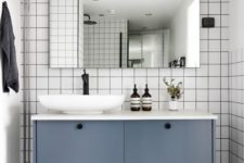 12 a floating bathroom vanity of an IKEA Metod cabinet with petrol blue paint and knobs is a stylish piece you can DIY