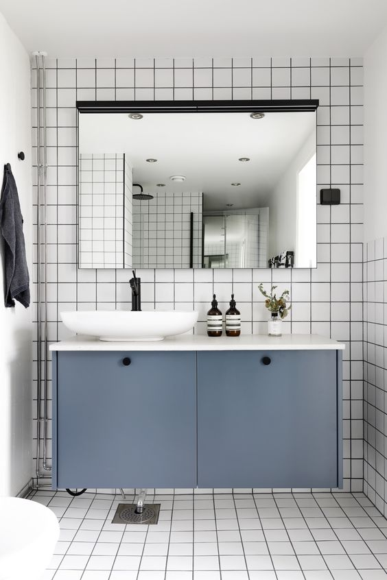 a floating bathroom vanity of an IKEA Metod cabinet with petrol blue paint and knobs is a stylish piece you can DIY