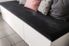 14 a comfortable bench of IKEA Metod cabinets and a soft grey cushion on top is an functional sitting unit