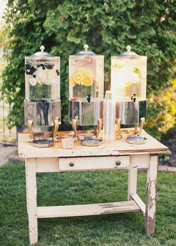 a shabby chic drink station with large drink tanks on metal stands is all you need for a cool look