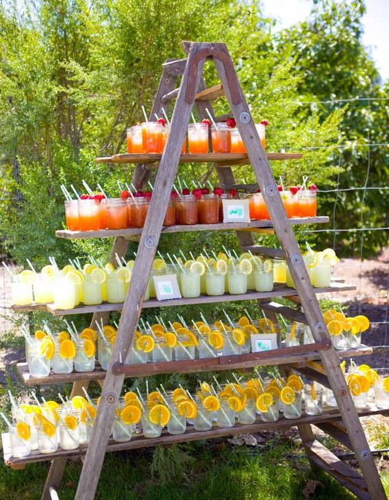 a step ladder with large shhelves is a very cool and simple outdoor drink station