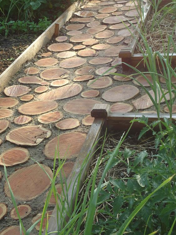 a wood slice garden path with wooden borders looks pretty natural and rustic, you can DIY one fast