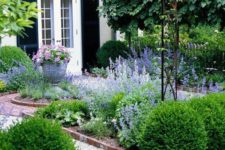 a small garden design with cool gravel pathways