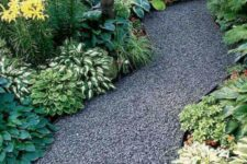 a gravel garden path with borders will prevent gravel entering your garden beds and other spaces