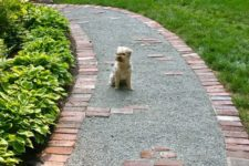 a gravel pathway lined with red bricks is a stylish and timeless idea, and your gravel won't finish on the lawn