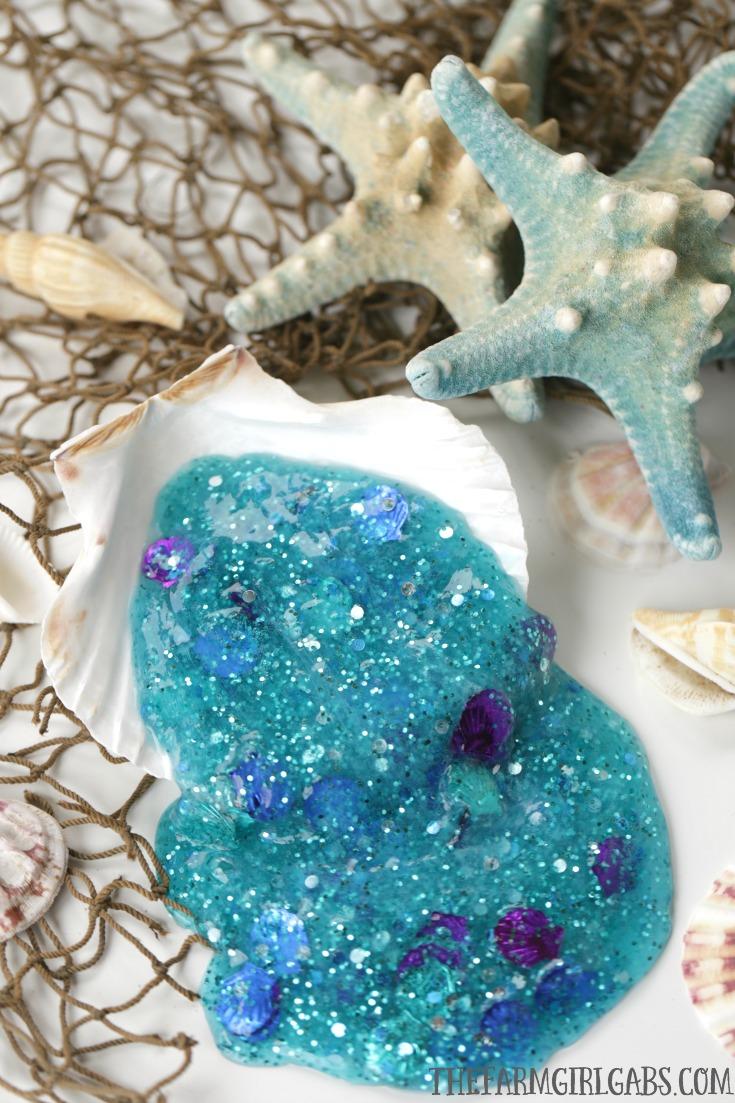 DIY turquoise glitter mermaid slime  (via thefarmgirlgabs.com)