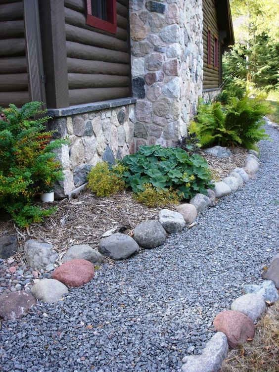 gravel and some stones match the stone cottage and look not too wild yet not too groomed