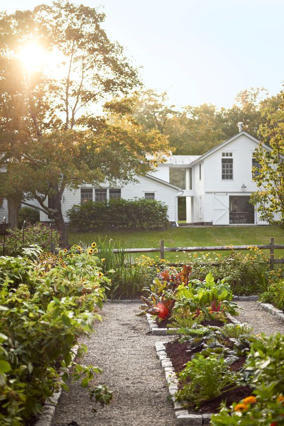 gravel pathways and brick lined garden beds for a cozy and welcoming garden with a rustic feel