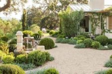 light-colored path gravel will make your garden very welcoming and will make it look very well-groomed