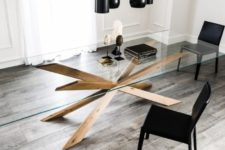 03 a chic dining table with a large glass tabletop and creatively place legs of solid wood looks wow