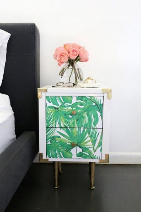 a cute and elegant tropical leaf nightstand with chic metallic touches is very glam