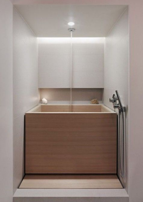 a square wooden bathtub for soaking will easily fit a minimalist bathroom and highlight the style