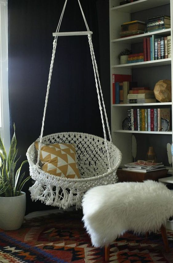 a bucket macrame hanging chair with tassels and fringe will add a boho feel to the space