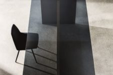 04 a chic smoked glass dining table with a comfy wooden base is ideal fro a minimalist dining room