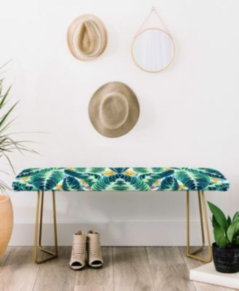 a tropical leaf printed bench with brass legs is an ultimate idea for a boho chic entryway