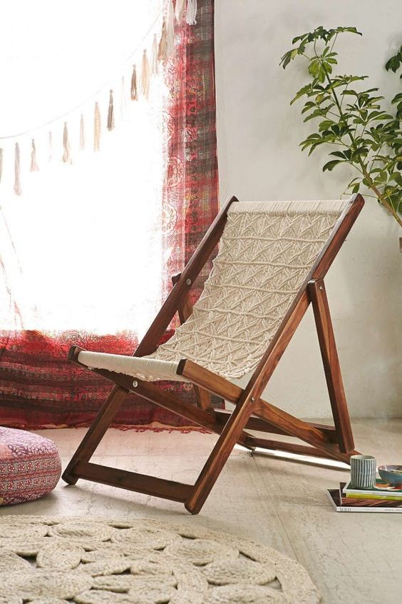 a macrame folding chair shows off the contrast between rich stained wood and white macrame