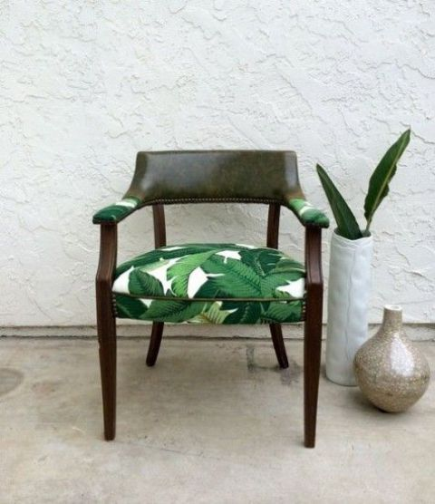reupholster a usual chair with banana leaf printed fabric to give it a tropical feel