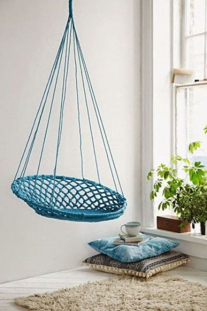 a simple turquoise macrame hanging chair will add color to the space