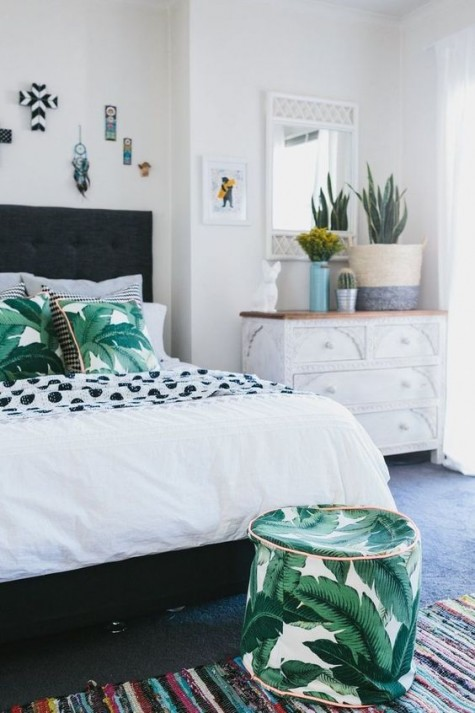 tropical leaf printed pillows and a small ottoman to match will make your bedroom feel tropical and boho