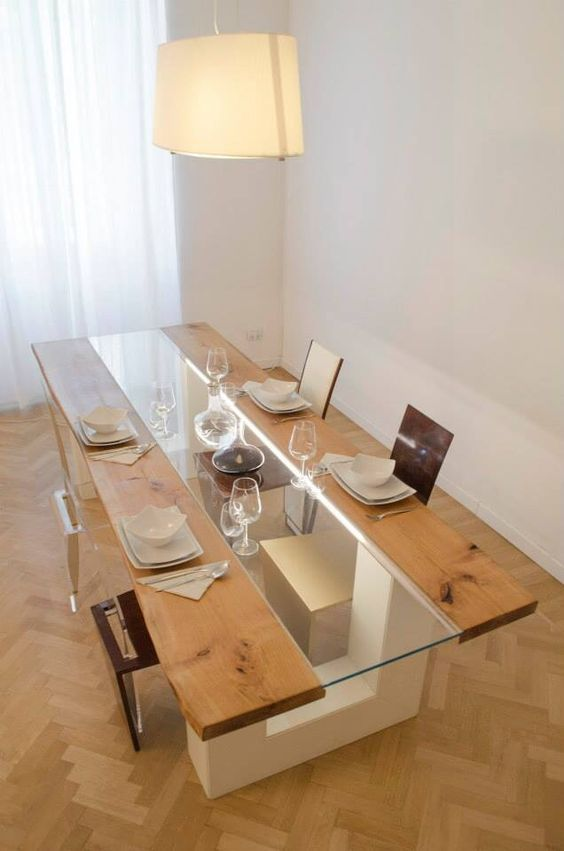 a wooden table with a glass insert in the center and creative geometric legs to hold the tabletop