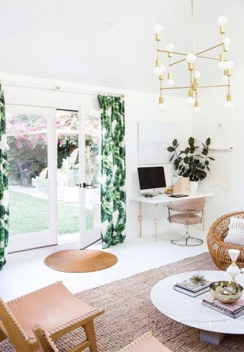 tropical leaf printed curtains plus gilded touches bring a glam feel to this boho chic space