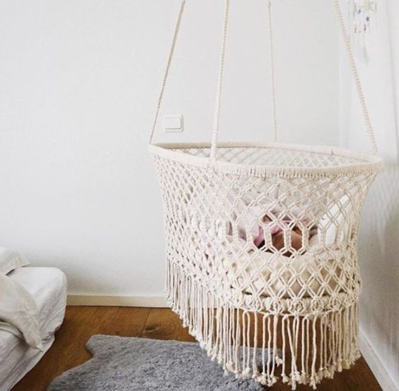 a macrame bassinet is just too cute to be true, perfect for a boho nursery