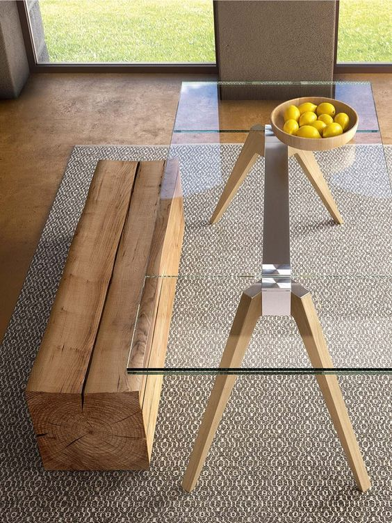 a table with a metal frame and wooden legs and a clear glass tabletop is ideal for a minimalist or contemporary space