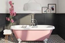 12 an elegant monochromatic bathroom with a pink clawfoot bathtub that adds a girlish touch to the space
