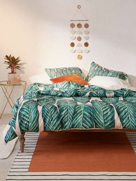 tropical leaf printed bedding is an easy way to add summer cheer to your bedroom
