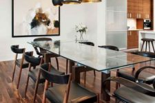 13 a stunning dining table with dark stained legs and a glass tabletop is complemented with dark chairs