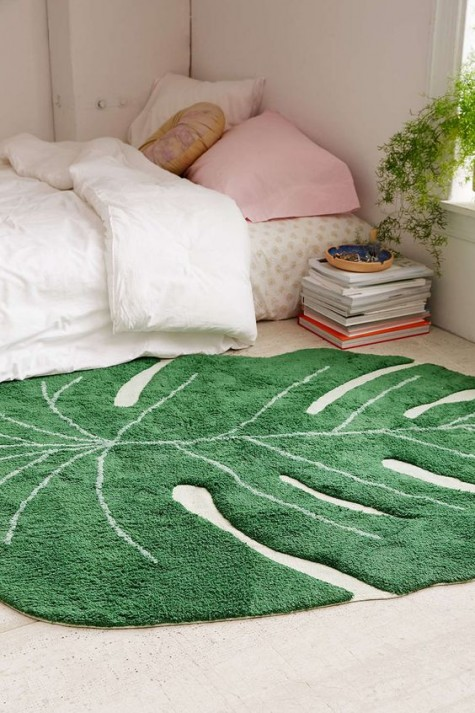 rock a monstera leaf rug to make your space summer-like for cheap