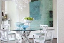 15 a creative dining table with a round blue glass tabletop and whitewashed driftwood to hold it