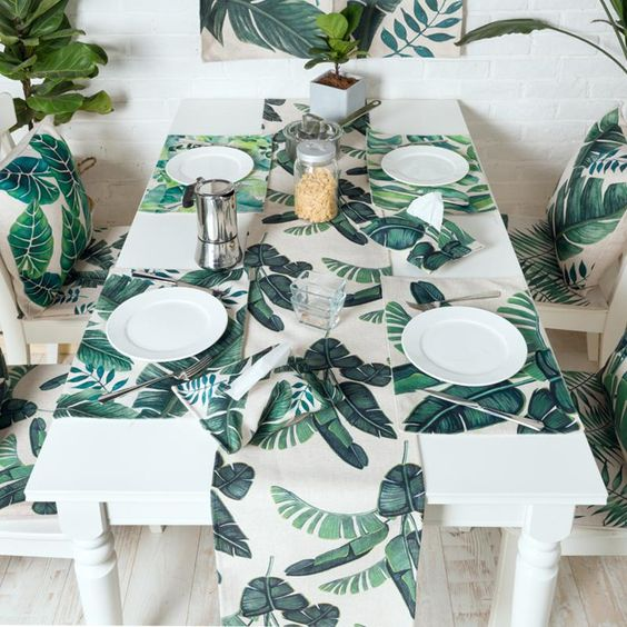 banana leaf print placemats and a table runner will cheer up your tablescape