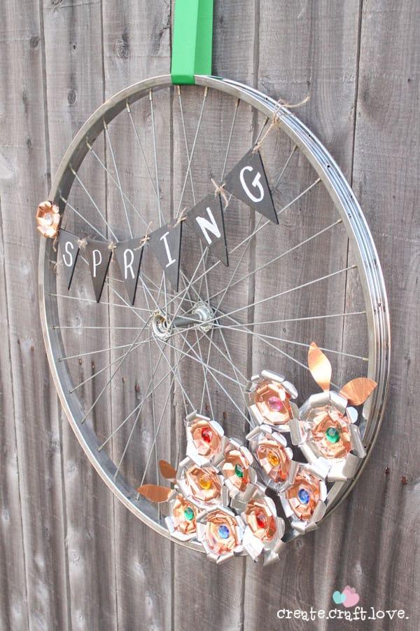DIY metal flower bike wheel wreath (via www.createcraftlove.com)
