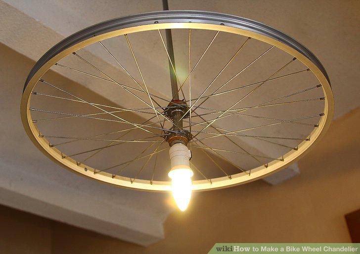 DIY simple bike wheel chandelier with a bulb (via www.wikihow.com)