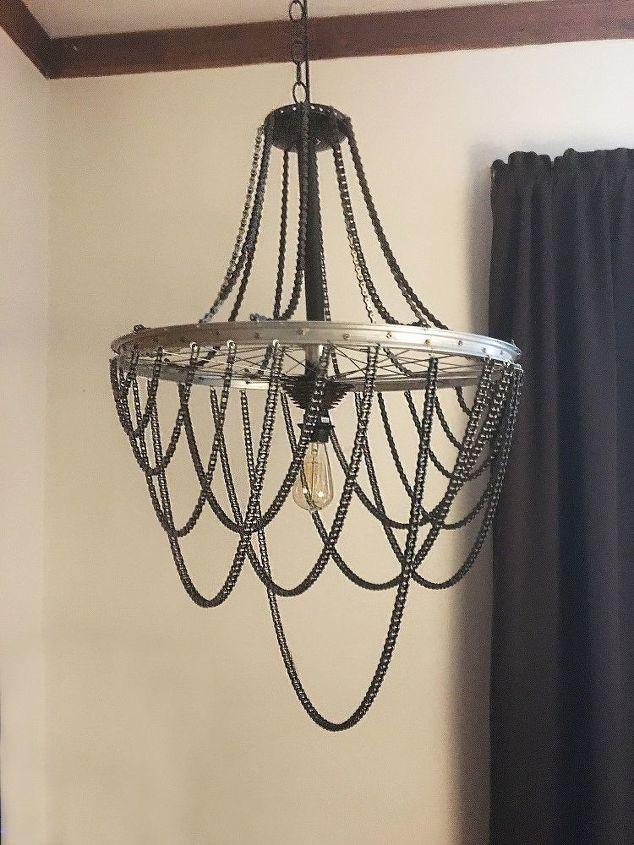 DIY industrial chandelier of a bike wheel with chains (via www.hometalk.com)