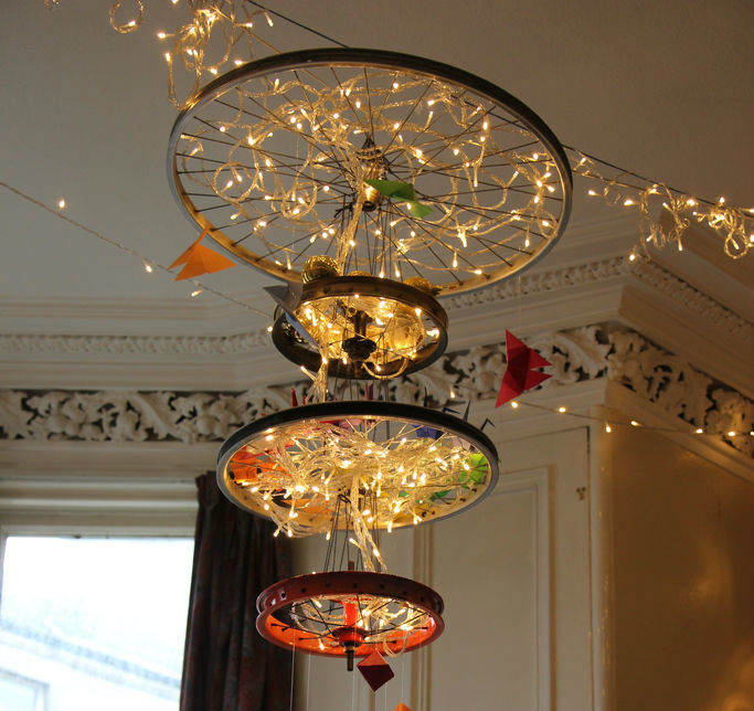 DIY large bike wheel chandelier with many lights (via www.instructables.com)