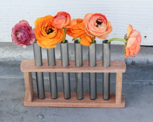 DIY wood and test tube installation with blooms (via www.shelterness.com)
