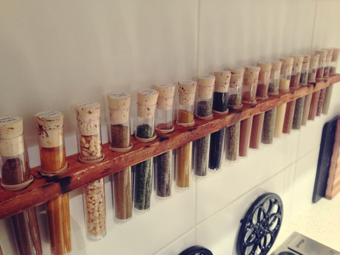 DIY wall-mounted spice rack with test tubes and cork (via project.theownerbuildernetwork.co)