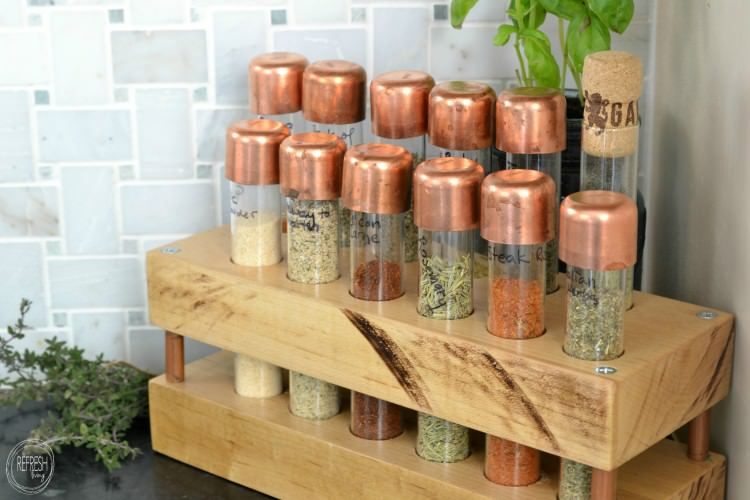 DIY polished wood spice rack with test tubes and copper lids (via refreshliving.us)