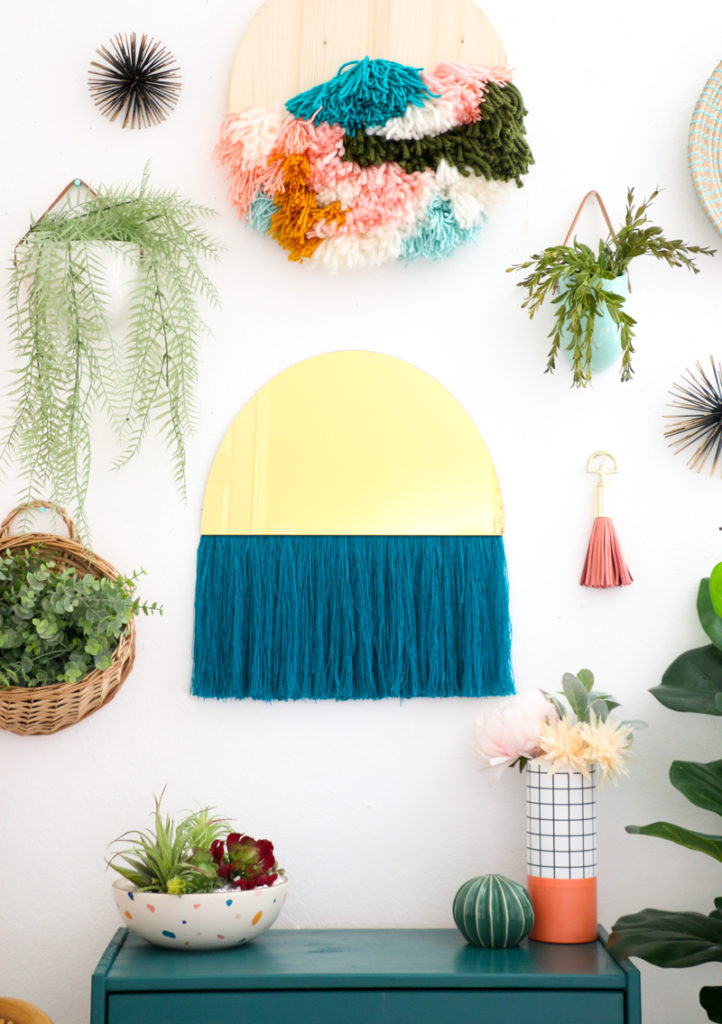 DIY gold acrylic semi circular mirror with long blue fringe (via undefined)
