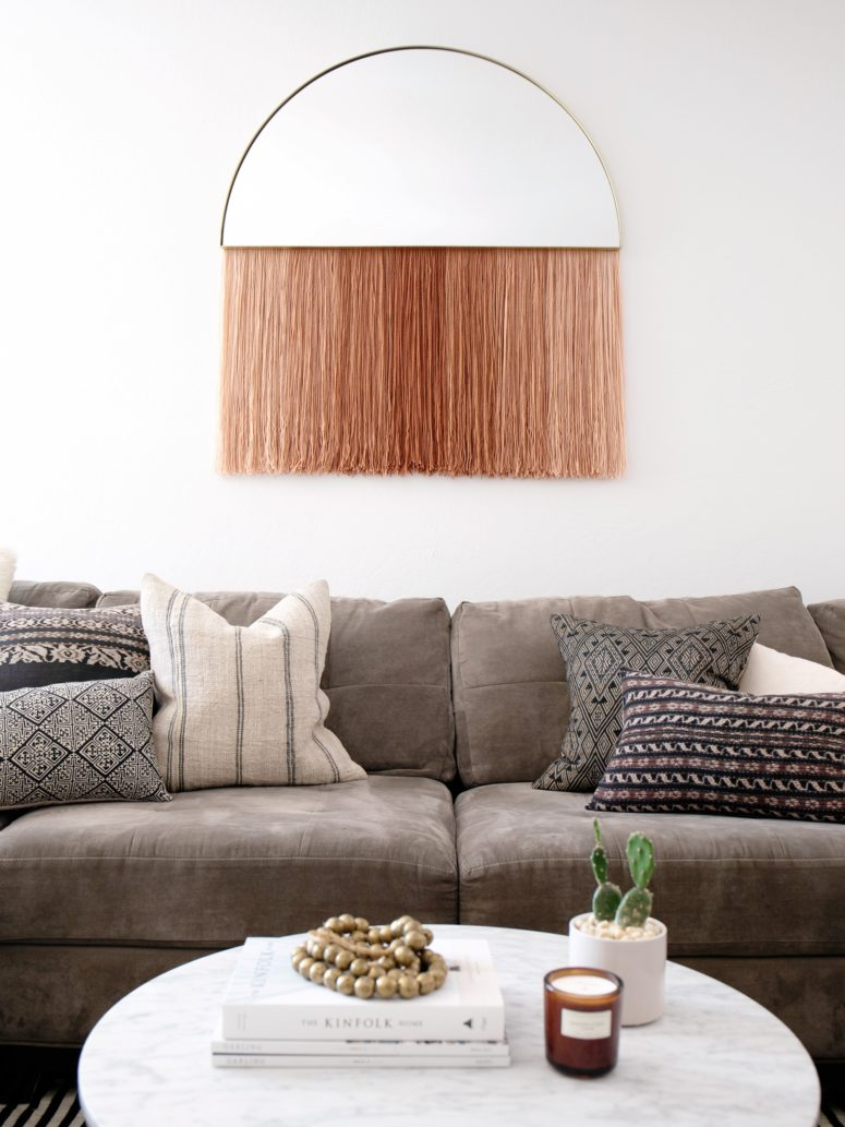 DIY half circle mirror with blush fringe (via undefined)