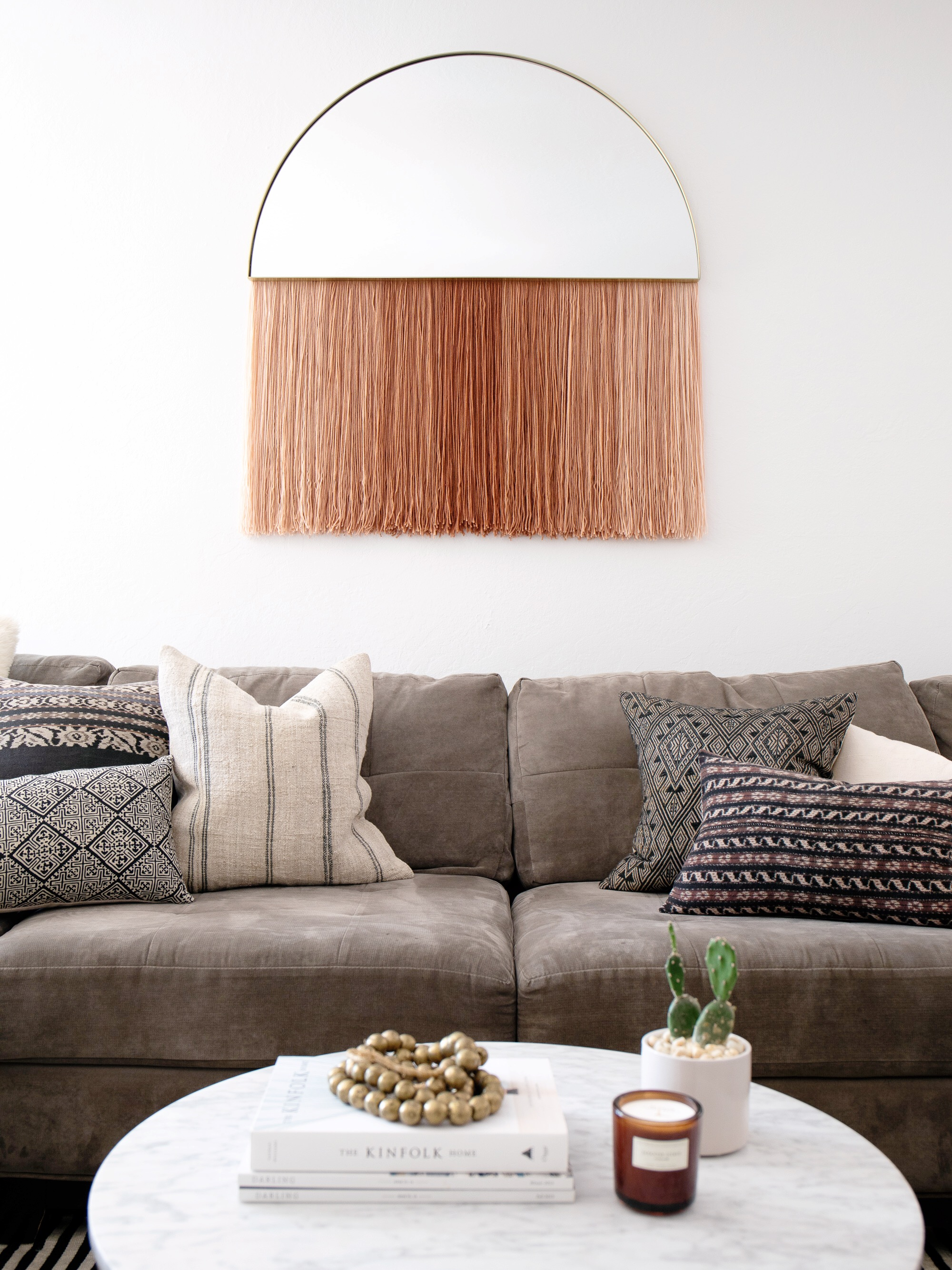 DIY half circle mirror with blush fringe