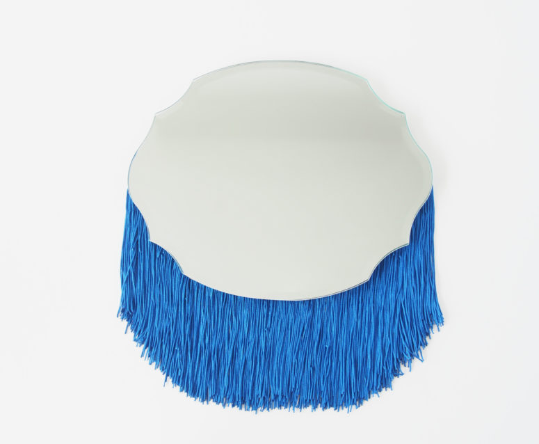 DIY quirky-shaped mirror with bright blue fringe (via undefined)