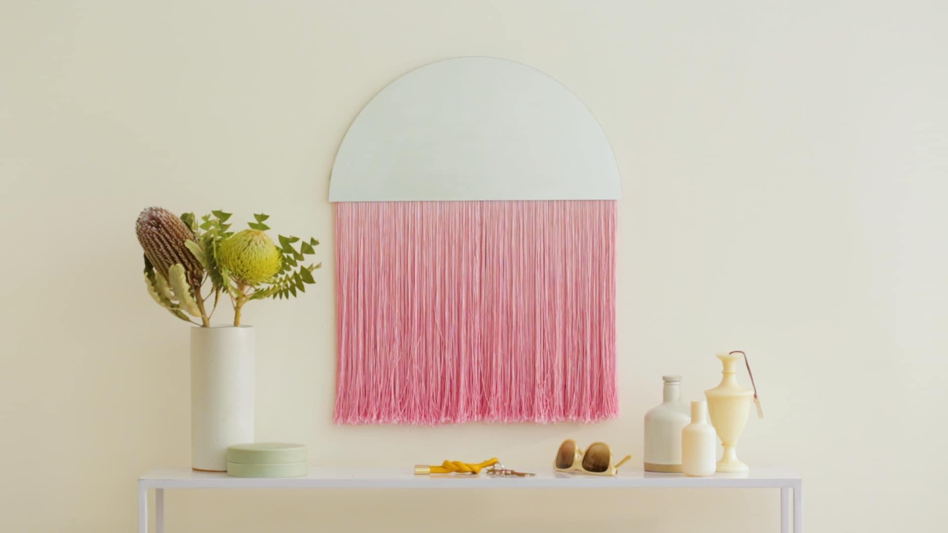 DIY semi circle mirror with pink fringe