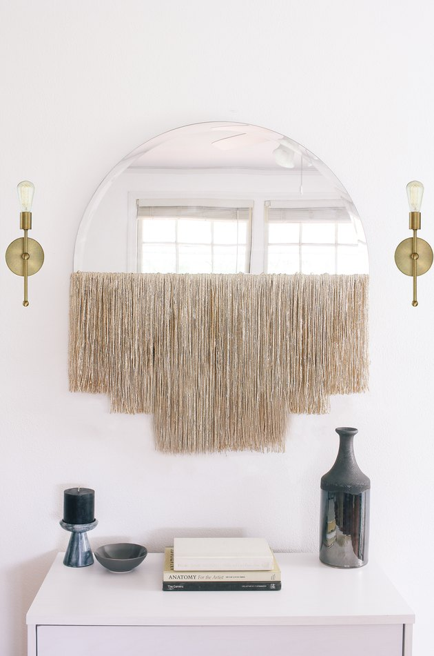 DIY semi circular mirror with long champagne-colored shiny fringe (via undefined)