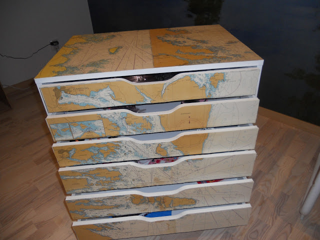 DIY IKEA Alex drawer hack with naval charts (via www.ikeahackers.net)
