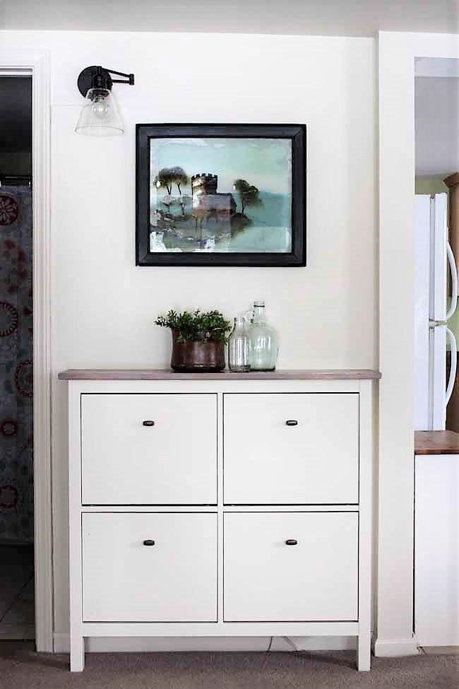DIY rustic Hemnes shoe cabinet hack with a wooden countertop and new knobs