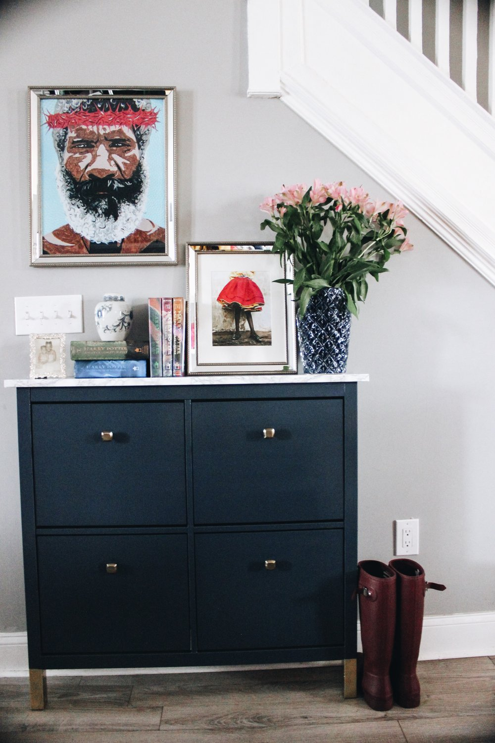 DIY navy IKEA Hemnes shoe cabinet with a marble tabletop