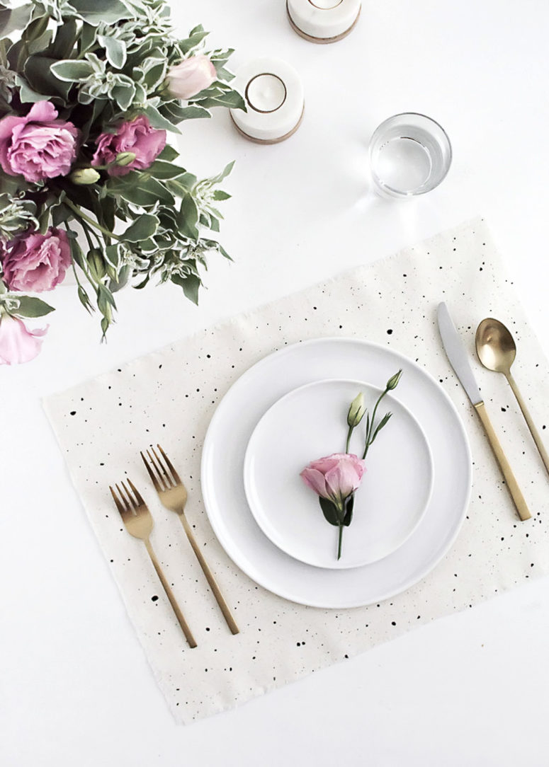 DIY simple black and white speckled placemats (via www.homeyohmy.com)